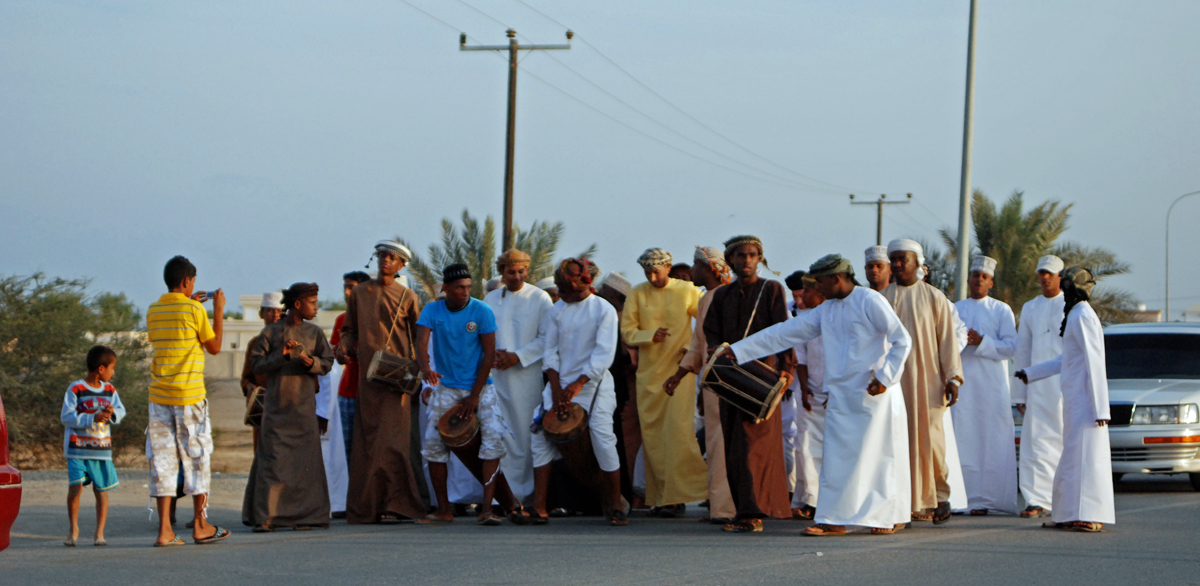 A wedding procession along the route. The bridegroom and his friends on the way to the bride to be.....