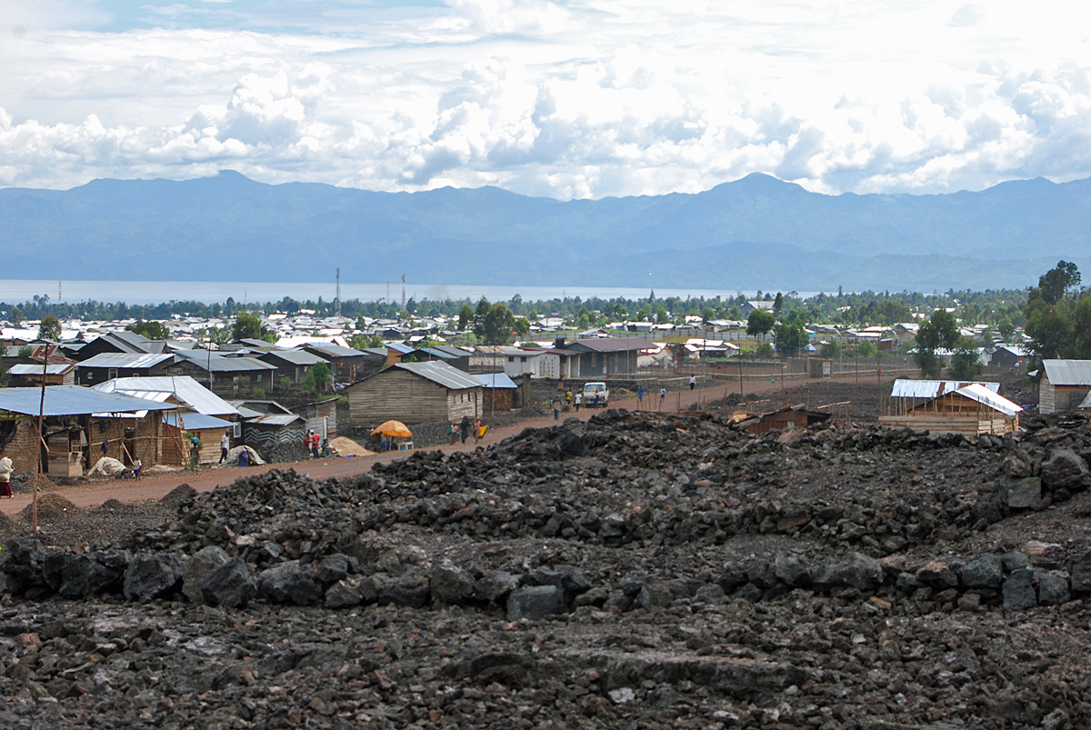 n January 2002, Nyiragongo erupted, sending a stream of lava 200 metres (219 yd) to one kilometre (1,100 yd) wide and up to two metres (6½ ft) deep through the center of the city as far as the lake shore. Agencies monitoring the volcano were able to give a warning and most of the population of Goma evacuated to Gisenyi. The lava destroyed 40% of the city (more than 4,500 houses and buildings).