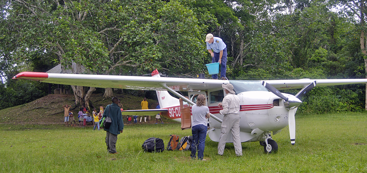 Captain Jon Cadd preparing for another odd flight. This time with a bunch of explorers who feared the long drive from Epulu to Kisangani in a car on the worst road on earth. So, Jeff, always generous, decided 2 hours was better!