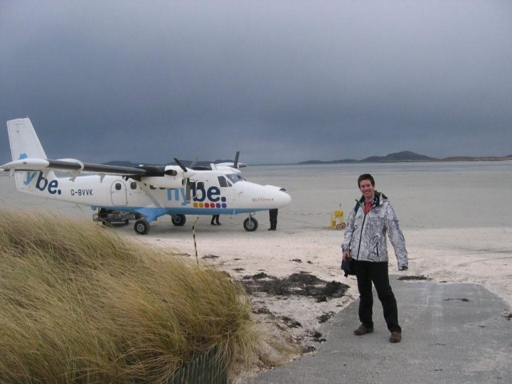 : on the small airfield of Barra, one of most amazing places I have ever been to, so unknown yet so close. This whole thing is a sand beach used as an airstrip at low tide. If it wasn't the constant wind and rain, this place would be Europe's number 2 Costa del Sol. Luckily nature saved it from overdevelopment.