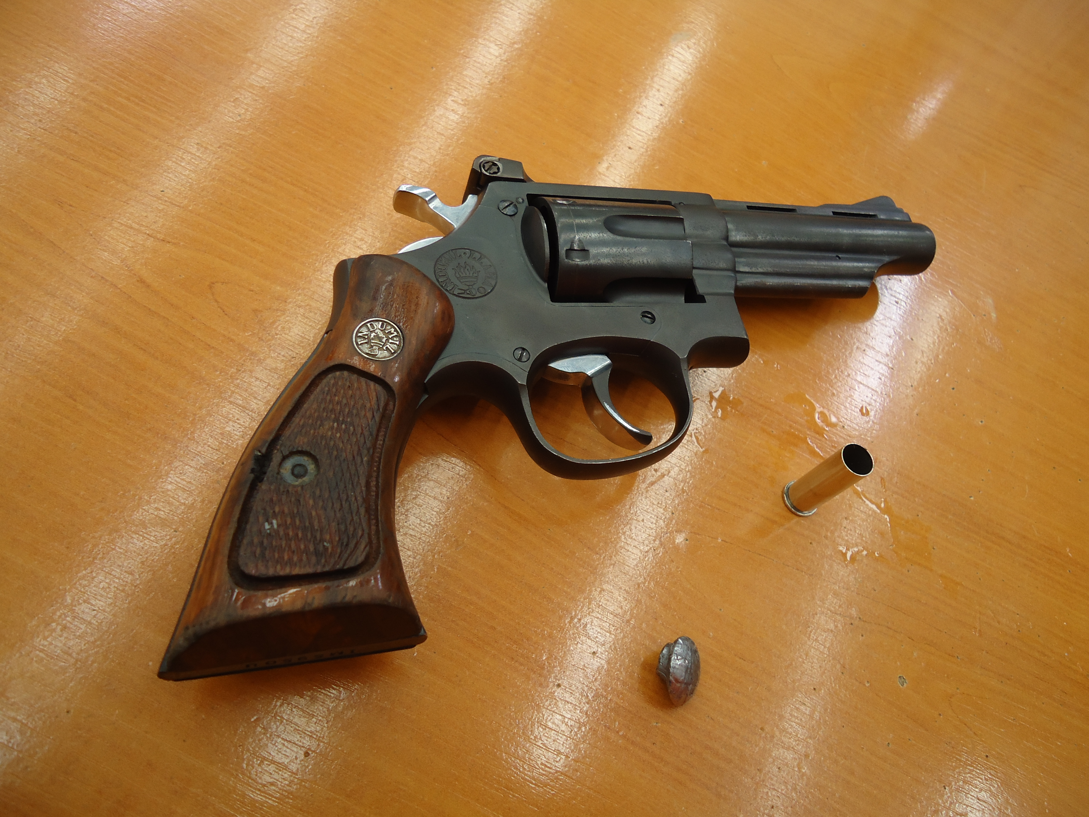 The .38 caliber long pistol Miguel Caballero used to shoot author Jim Clash, with spent shell casing and bullet lead.