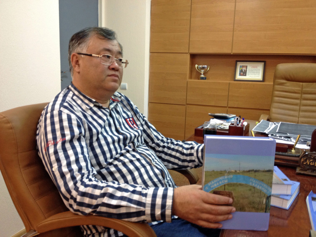 Dr Nurlan Dulatbekov with one of many books he has published.